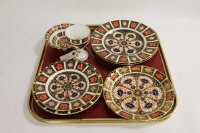 Five Royal Crown Derby cabinet plates, pattern 1128, together with a small goblet, and two bowls. (8)