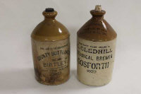 Two advertising stoneware flagons - County Bottling Co. Birtley 1925 and G.Gledhill Botanical Brewer Gosforth 1923. (2)