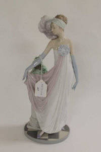 A Lladro figure - Lady standing by a pillar, height 34.5 cm.