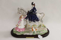 A Coalport figure - A flower for my lady, limited edition 99/250, on plinth, boxed.