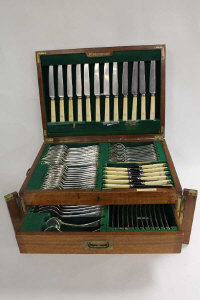 A mahogany canteen of silver cutlery, Elkington & Co,128 oz.