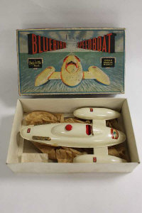 A Sutcliffe Bluebird II Speedboat, boxed, with key, together with Sutcliffe Sea Wolf Atomic Submarine, boxed,  an airliner flying toy, tin plated Air France aeroplane and an Adventure Tank, boxed.(5).