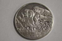 A silver coin with detail from The Last Supper, together with forty eight similar coins.