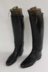 A pair of early twentieth century black leather Lady's riding boots, with wooden trees. (2)