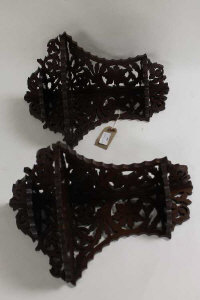 A pair of mahogany fret-work carved corner brackets. (2)