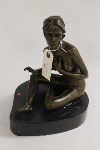 A bronze study of a naked lady on black marble heart-shaped plinth, height 24.5 cm.
