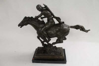 A bronze study of a Native American on horseback, on black marble plinth, height 50 cm.