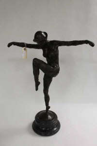 After D.H.Chiparus - bronze study of an Art Deco style dancer with knee raised, on black marble socle, height 70 cm.
