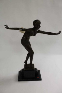 After D.H. Chiparus - A bronze study of an Art Deco style dancer, on black marble plinth, height 48 cm.