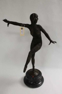 After D.H.Chiparus - A bronze study of an Art Deco style dancer, on black marble socle, height 65 cm.