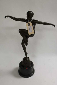 After D.H.Chiparus, a bronze study of a dancing lady with her knee raised, on grey marble socle, height 48 cm.