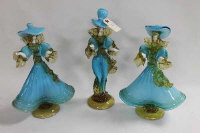 Three Murano three-tone glass figures. (3)
