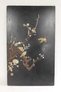 An early twentieth century Japanese lacquered panel, together with a similar four-fold screen. (2)