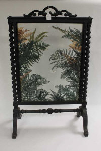 A Victorian glazed fire screen with foliage detail, height 95 cm.