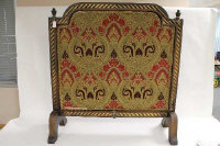 A Victorian style embroidered fire screen, height 102 cm.