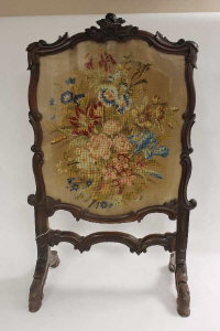 A Victorian carved oak tapestry fire screen, height 100 cm.