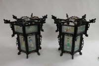A pair of Chinese wooden and panelled glass lanterns. (2)