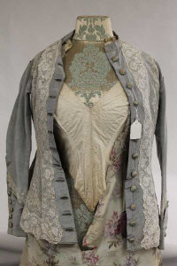 A nineteenth century style embroidered dress on mannequin, height 152 cm.