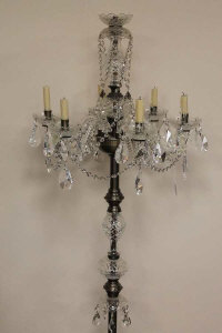 A set of six crystal floor standing candelabra. (6)