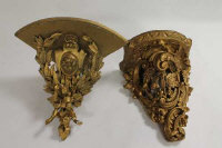 Two gilt-wooden wall brackets. (2)