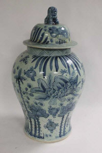 A pair of Chinese blue and white lidded temple urns, height 64 cm. (2)