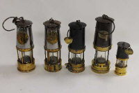 A Patterson miner's lamp numbered 1076, together with four other miner's lamps. (5)