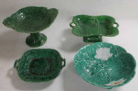 Seventeen nineteenth century cabbage leaf plates and dishes. (17)