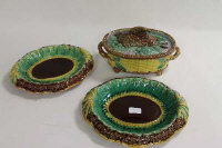 A majolica lidded game dish, together with two majolica plates. (3)