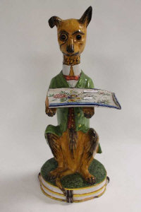 A nineteenth century continental faience butler stand modelled as a hound, height 56 cm.
