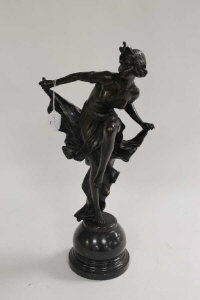 After A. Gory - bronze study of a lady dancing, on black marble socle, height 51 cm.