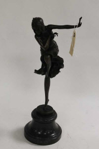 After D.H.Chiparus - bronze study of a lady with knee raised, on black marble socle, height 40 cm.