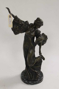 A bronze study of a lady touching her heel, on black marble base, height 47 cm.
