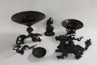 Two oriental bronze dragon figures, together with two bowls on stands, a small bowl and figure of a gentleman. (6)