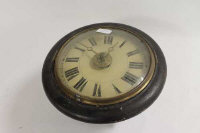 An early twentieth century alarm wall clock, diameter 32 cm.