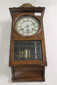 A nineteenth century oak wall clock, height 47 cm.