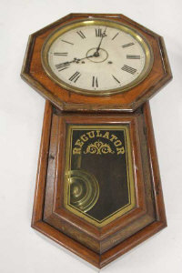 A rosewood regulator wall clock, height 80 cm.