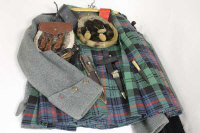 A tartan kilt, together with two tunics, two sporrans, belt and dirks.