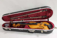 A violin made by Tim Phillips, instrument number 263, back length 36 cm, together with two bows, cased.
