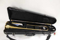 A Yamaha trombone, with mouth piece, cased.