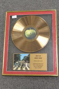 A limited edition gold-disc - Beatles Abbey road, framed.