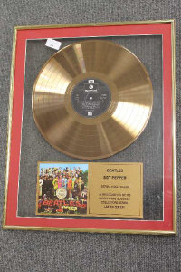A limited edition gold-disc - Beatles Sgt.Pepper,framed.