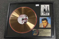 A limited edition gold-disc - Elvis Loving you, framed.
