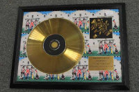 A limited edition gold-disc - Rolling Stones Rolled Gold, framed.