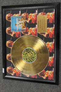 A limited edition gold-disc - Elton John Greatest Hits, framed.