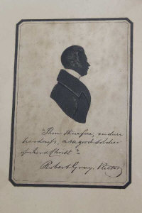 An early nineteenth century silhouette depicting Robert Grey, 13 cm x 19 cm, with black ink inscription, framed.