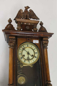 An Edwardian mahogany wall clock.