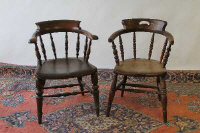 Two early twentieth century half-smoker chairs. (2)