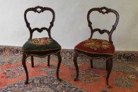 A pair of Victorian walnut salon chairs. (2)