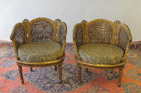 A pair of gilt wood double-bergere backed tub chairs. (2)