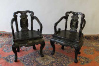 A pair of Chinese lacquered armchairs. (2)